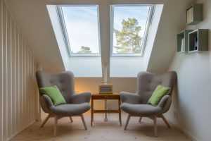 Two skylights with two chairs & table, sitting nook