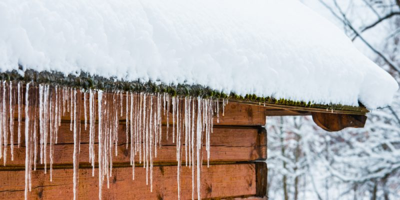 Icicles on gutters, with snowy roof